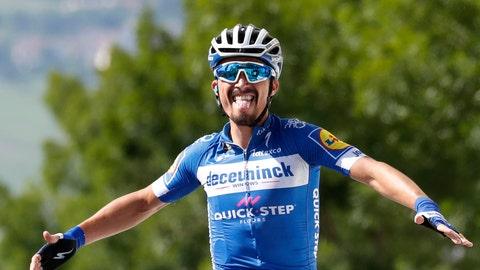 <p>               France's Julian Alaphilippe celebrates as he crosses the finish line to win the third stage of the Tour de France cycling race over 215 kilometers (133,6 miles) with start in Binche and finish in Epernay, Monday, July 8, 2019. (AP Photo/Christophe Ena)             </p>