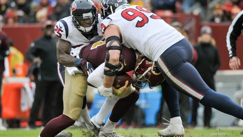 <p>               FILE - In this Nov. 18, 2018, file photo, Washington Redskins quarterback Alex Smith (11) injures his ankle as he is sacked by Houston Texans defensive end J.J. Watt (99) and Houston Texans strong safety Kareem Jackson (25) during the second half of an NFL football game, in Landover, Md. Alex Smith has finally shed the massive brace on his right leg eight months after breaking his tibia and fibula in gruesome fashion. Smith's wife, Elizabeth, posted a photo Monday, July 15, 2019, of him holding the ring external fixator in his hand. (AP Photo/Mark Tenally, File)             </p>