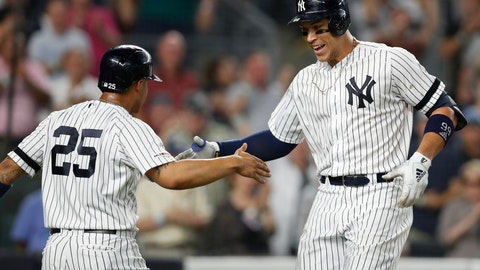 <p>               New York Yankees' Aaron Judge, right, celebrates with Gleyber Torres (25), who scored on Judge's two-run home run during the eighth inning of a baseball game against the Tampa Bay Rays, Tuesday, July 16, 2019, in New York. (AP Photo/Kathy Willens)             </p>