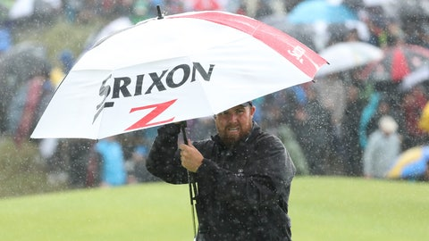 <p>               Ireland's Shane Lowry holds an umbrella in heaven rain on the 8th green during the final round of the British Open Golf Championships at Royal Portrush in Northern Ireland, Sunday, July 21, 2019.(AP Photo/Peter Morrison)             </p>