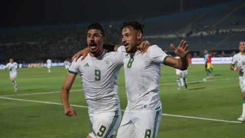 <p>               Algeria's Baghdad Bounedjah, left, and Mohamed Belaili celebrate after a goal during the African Cup of Nations round of 16 soccer match between Algeria and Guinea in 30 June stadium in Cairo, Egypt, Sunday, July 7, 2019. (AP Photo/Hassan Ammar)             </p>