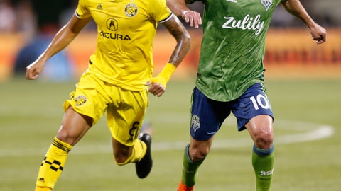 <p>               Seattle Sounders' Nicolas Lodeiro, right, dribbles past Columbus Crew's Artur during the second half of an MLS soccer match Saturday, July 6, 2019, in Columbus, Ohio. The Sounders won 2-1. (AP Photo/Jay LaPrete)             </p>