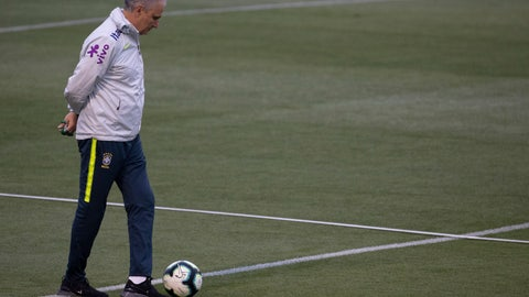 <p>               Brazil's coach Tite walks on the field during a practice session at the Granja Comary training center in Teresopolis, Brazil, Thursday, July 4, 2019. Brazil will play against Peru for the final of the Copa America on July 7. (AP Photo/Leo Correa)             </p>