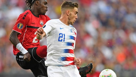 <p>               U.S. forward Tyler Boyd plays the ball against Trinidad and Tobago defender Aubrey David during the first half of a CONCACAF Gold Cup soccer match Saturday, June 22, 2019, in Cleveland. (AP Photo/David Dermer)             </p>