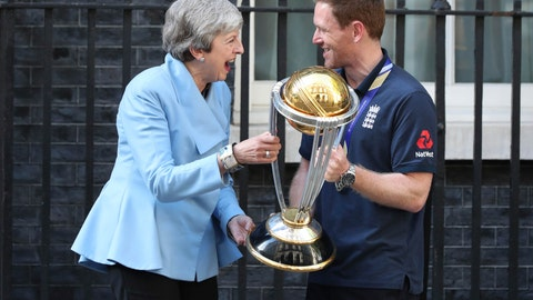 <p>               Britain's Prime Minister Theresa May laughs with England cricket captain Eoin Morgan and the trophy after England won the Cricket World Cup, outside Downing Street in London, Monday, July 15, 2019. (Yui Mok/PA via AP)             </p>