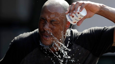 <p>               Baltimore Orioles outfielder Keon Broxton douses himself with water while taking a break between fielding and batting practice prior to a baseball game against the Boston Red Sox, Friday, July 19, 2019, in Baltimore. A heat wave is hitting Baltimore and heat advisories have been set ahead of a hot weekend. (AP Photo/Julio Cortez)             </p>