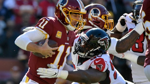 <p>               FILE - In this Nov. 4, 2018, file photo, Washington Redskins quarterback Alex Smith, left, is sacked by Atlanta Falcons defensive tackle Grady Jarrett during an NFL football game in Landover, Md. The Falcons have agreed to terms with Jarrett on a four-year contract extension before the NFL deadline for franchise-tagged players. (AP Photo/Mark Tenally, File)             </p>