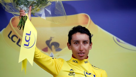 <p>               New overall leader Colombia's Egan Arley Bernal Gomez wearing the yellow jersey celebrates on the podium after the nineteenth stage of the Tour de France cycling race with start in Saint Jean De Maurienne, France, Friday, July 26, 2019. Tour de France organizers stopped Stage 19 of the race because of a hail storm as Julien Alaphilippe lost his yellow jersey to Egan Bernal. (AP Photo/Christophe Ena)             </p>