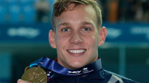 <p>               Gold medalist United States' Caeleb Dressel poses with his medal following the men's 100m butterfly final at the World Swimming Championships in Gwangju, South Korea, Saturday, July 27, 2019. (AP Photo/Lee Jin-man)             </p>