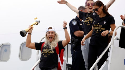 <p>               Members of the United States women's soccer team, winners of a fourth Women's World Cup, including Julie Ertz, left, Megan Rapinoe, top center, and Alex Morgan, top right, celebrate after arriving at Newark Liberty International Airport, Monday, July 8, 2019, in Newark, N.J. (AP Photo/Kathy Willens)             </p>