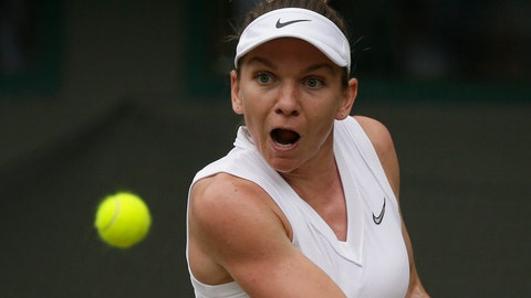 <p>               Romania's Simona Halep returns the ball to China's Shuai Zhang during a women's quarterfinal match on day eight of the Wimbledon Tennis Championships in London, Tuesday, July 9, 2019. (AP Photo/Tim Ireland)             </p>