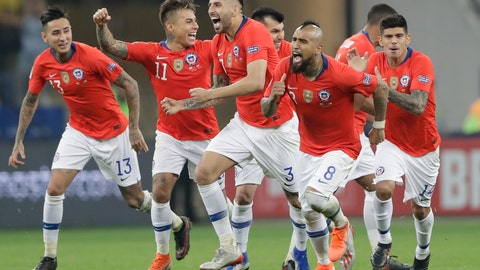<p>               Chile's players, from left to right, Esteban Pavez, Arturo Vidal, Guillermo Maripan, Eduardo Vargas and Erick Pulgar celebrate beating Colombia 5-4 in a penalty kick shoot-out in a Copa America quarterfinal soccer match at the Arena Corinthians in Sao Paulo, Brazil, Friday, June 28, 2019. Chile qualified to the semifinals of the South American soccer tournament. (AP Photo/Andre Penner)             </p>