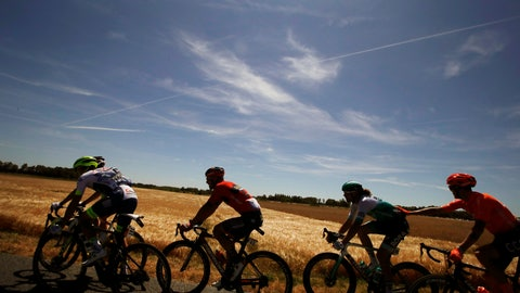 <p>               The pack rides during the fourth stage of the Tour de France cycling race over 214 kilometers (133 miles) with start in Reims and finish in Nancy, France, Tuesday, July 9, 2019. (AP Photo/Christophe Ena)             </p>