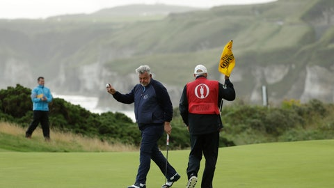 <p>               Northern Ireland's Darren Clarke acknowledges the crowd after getting a birdie on the 5th green during the first round of the British Open Golf Championships at Royal Portrush in Northern Ireland, Thursday, July 18, 2019.(AP Photo/Matt Dunham)             </p>
