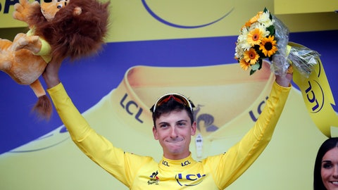 <p>               Italy's Giulio Ciccone celebrates with the overall leader's yellow jersey on the podium, at the end of the sixth stage of the Tour de France cycling race over 160 kilometers (100 miles) with start in Mulhouse and finish in La Planche des Belles Filles, France, Thursday, July 11, 2019. (AP Photo/Christophe Ena)             </p>