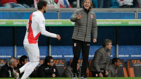 <p>               Peru's coach Ricardo Gareca, center, gives instructions to Luis Abram during a Copa America semifinal soccer match against Chile at the Arena do Gremio in Porto Alegre, Brazil, Wednesday, July 3, 2019. (AP Photo/Silvia Izquierdo)             </p>