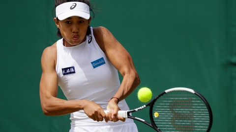 <p>               China's Shuai Zhang returns to Denmark's Caroline Wozniacki in a Women's singles match during day five of the Wimbledon Tennis Championships in London, Friday, July 5, 2019. (AP Photo/Kirsty Wigglesworth)             </p>