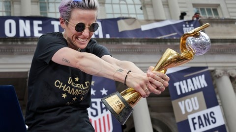 <p>               U.S. women's soccer player Megan Rapinoe celebrates with the FIFA Women's World Cup trophy at City Hall after a ticker tape parade, Wednesday, July 10, 2019 in New York. The U.S. national team beat the Netherlands 2-0 to capture a record fourth Women's World Cup title. (AP Photo/Seth Wenig)             </p>