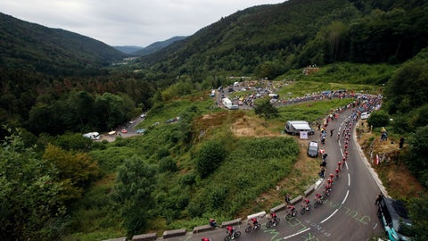 <p>               The pack rides during the sixth stage of the Tour de France cycling race over 160 kilometers (100 miles) with start in Mulhouse and finish in La Planche des Belles Filles, France, Thursday, July 11, 2019. (AP Photo/Christophe Ena)             </p>