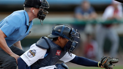 <p>               Home plate umpire Brian deBrauwere, left, huddles behind Freedom Division catcher James Skelton, of the York Revolution, as the official wears an earpiece during the first inning of the Atlantic League All-Star minor league baseball game, Wednesday, July 10, 2019, in York, Pa. deBrauwere wore the earpiece connected to an iPhone in his ball bag which relayed ball and strike calls upon receiving it from a TrackMan computer system that uses Doppler radar. The independent Atlantic League became the first American professional baseball league to let the computer call balls and strikes during the all star game. (AP Photo/Julio Cortez)             </p>