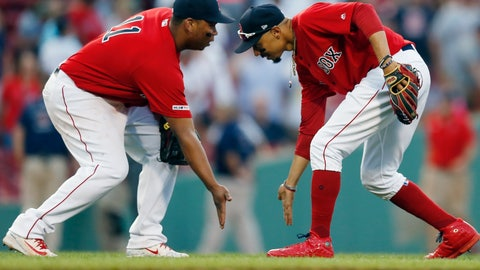 <p>               Boston Red Sox's Mookie Betts, right, and Rafael Devers celebrate after defeating the New York Yankees during a baseball game in Boston, Saturday, July 27, 2019. (AP Photo/Michael Dwyer)             </p>