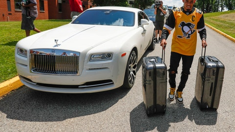 <p>               Pittsburgh Steelers cornerback Joe Haden rolls suitcases past his car as he arrives for NFL football training camp in Latrobe, Pa., Thursday, July 25, 2019. (AP Photo/Keith Srakocic)             </p>