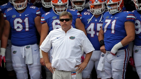 <p>               FILE - In this Oct. 28, 2017 file photo then-Florida head coach Jim McElwain, center, prepares to take the field with players before the first half of an NCAA college football game in Jacksonville, Fla. Central Michigan's Jim McElwain is one of four coaches entering their first seasons in the Mid-American Conference. (AP Photo/John Raoux)             </p>