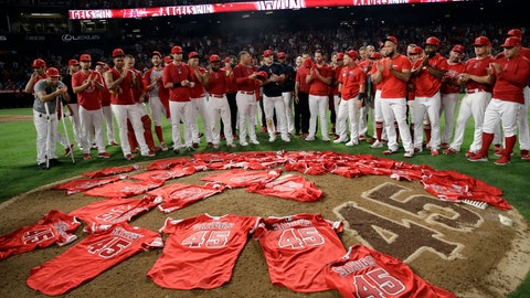 <p>               Members of the Los Angeles Angels place their jerseys with No. 45 in honor of pitcher Tyler Skaggs on the mound after a combined no-hitter against the Seattle Mariners during a baseball game Friday, July 12, 2019, in Anaheim, Calif. The Angels won 13-0. (AP Photo/Marcio Jose Sanchez)             </p>
