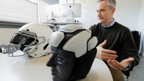 <p>               In this photo taken May 23, 2019, Dave Marver, CEO of VICIS, a Seattle-based company that makes football helmets, talks in Seattle about his company's latest offering, the ULTIM cap. VICIS announced on Monday, July 1, the cap is intended for use with youth flag football and the quickly expanding competitive 7-on-7 football played during the offseason for youth and high school programs. (AP Photo/Ted S. Warren). (AP Photo/Ted S. Warren)             </p>