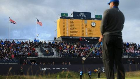 <p>               Tiger Woods of the United States prepares to chip onto the 18th green, as the scoreboard shows the leading players and Woods score been at bottom left, during the first round of the British Open Golf Championships at Royal Portrush in Northern Ireland, Thursday, July 18, 2019.(AP Photo/Jon Super)             </p>