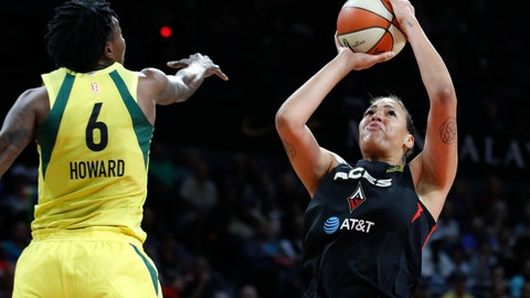 <p>               Las Vegas Aces' Liz Cambage shoots around Seattle Storm's Natasha Howard during the first half of a WNBA basketball game Tuesday, July 23, 2019, in Las Vegas. (AP Photo/John Locher)             </p>