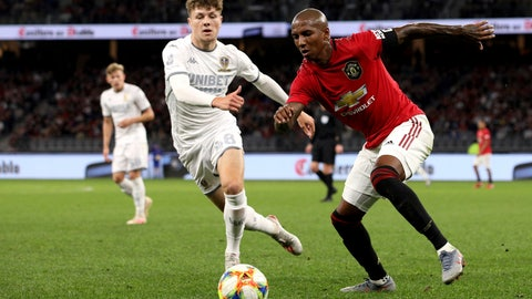 <p>               Ashley Young, right, of Manchester United and Jordan Stevens of Leeds United compete for the ball during their friendly soccer match in Perth, Australia, Wednesday, July 17, 2019. (Richard Wainwright/AAP Image via AP)             </p>