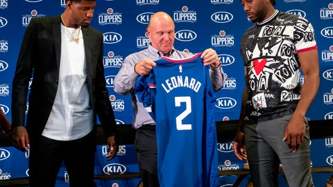 <p>               Los Angeles Clippers team chairman Steve Ballmer, center, presents a new team jersey to Kawhi Leonard, right, as Paul George looks on during a press conference in Los Angeles, Wednesday, July 24, 2019. Nearly three weeks after the native Southern California superstars shook up the NBA by teaming up with the Los Angeles Clippers, the dynamic duo makes its first public appearance. (AP Photo/Ringo H.W. Chiu)             </p>
