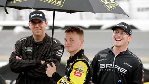 <p>               Justin Haley, center, waits on pit road in the rain with crew members after the NASCAR Cup Series auto race was stopped because of weather at Daytona International Speedway, Sunday, July 7, 2019, in Daytona Beach, Fla. Haley was declared the winner a short time later. (AP Photo/Terry Renna)             </p>