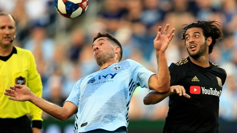 <p>               Sporting Kansas City midfielder Benny Feilhaber, left, keeps the ball from Los Angeles FC forward Carlos Vela, right, during the first half of an MLS soccer match in Kansas City, Kan., Wednesday, July 3, 2019. (AP Photo/Orlin Wagner)             </p>
