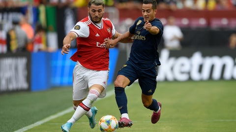 <p>               Real Madrid forward Lucas Vazquez, right, battles for the ball against Arsenal defender Sead Kolasinac, left, during the first half of an International Champions Cup soccer match, Tuesday, July 23, 2019, in Landover, Md. (AP Photo/Nick Wass)             </p>