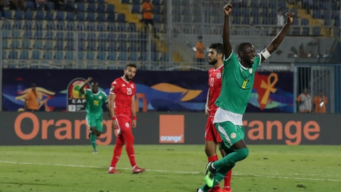 <p>               Senegal's Cheikhou Kouyate, left, celebrates after he scored during the African Cup of Nations semifinal soccer match between Senegal and Tunisia in 30 June stadium in Cairo, Egypt, Sunday, July 14, 2019. (AP Photo/Hassan Ammar)             </p>