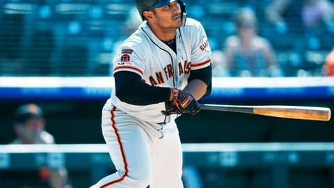 <p>               San Francisco Giants' Donovan Solano follows the flight of his RBI-double off Colorado Rockies relief pitcher Chad Bettis in the eighth inning of a baseball game Wednesday, July 17, 2019, in Denver. (AP Photo/David Zalubowski)             </p>