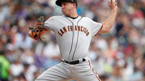 <p>               San Francisco Giants relief pitcher Derek Holland works against the Colorado Rockies in the fifth inning of a baseball game Wednesday, July 17, 2019, in Denver. (AP Photo/David Zalubowski)             </p>