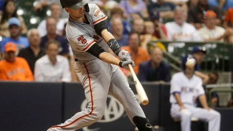 <p>               San Francisco Giants' Buster Posey hits a grand slam during the 10th inning of a baseball game against the Milwaukee Brewers Friday, July 12, 2019, in Milwaukee. (AP Photo/Morry Gash)             </p>