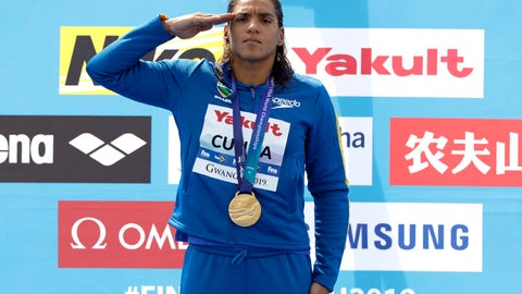 <p>               Gold medalist Ana Marcela Cunha of Brazil stands with her medal after the women's 5km open water swim at the World Swimming Championships in Yeosu, South Korea, Wednesday, July 17, 2019. (AP Photo/Mark Schiefelbein)             </p>