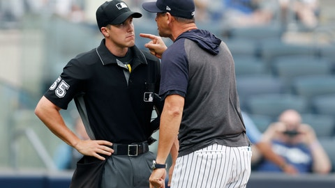 <p>               New York Yankees' manager Aaron Boone yells at home plate umpire Brennan Miller during the second inning of the first game of a baseball doubleheader against the Tampa Bay Rays' Thursday, July 18, 2019, in New York. (AP Photo/Kathy Willens)             </p>