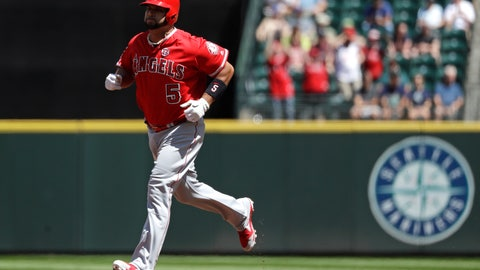 <p>               Los Angeles Angels' Albert Pujols rounds the bases on a solo home run against the Seattle Mariners in the second inning of a baseball game Sunday, July 21, 2019, in Seattle. (AP Photo/Elaine Thompson)             </p>