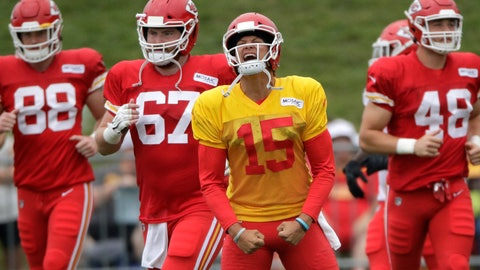 <p>               Kansas City Chiefs quarterback Patrick Mahomes (15) leads teammates onto the field for a drill during NFL football training camp Monday, July 29, 2019, in St. Joseph, Mo. (AP Photo/Charlie Riedel)             </p>