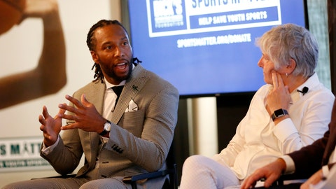 <p>               FILE - In this Thursday, July 18, 2019, file photo, NFL player Larry Fitzgerald, left, and Senior Director of Research and programs at The Women's Sports Foundation, Dr. Marjorie Snyder, serve as panelists at the DICK'S Sports Matter Panel Event in New York. Jon Gruden, Larry Fitzgerald and Alex Morgan have reached the summit of their professions. They all recognize the need for strong grass-roots sports programs, and they are doing something about it.  Working with DICK'S Sporting Goods Foundation, that trio announced a pledge to provide access to sports for one million youngsters over the next five years. DICK'S will match up to $1 million in donations made by customers to its foundation.  (Jason DeCrow/AP Images for DICK'S Sporting Goods, File)             </p>