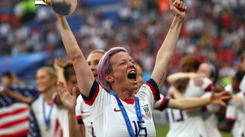<p>               United States' Megan Rapinoe holds the trophy celebrating at the end of the Women's World Cup final soccer match between US and The Netherlands at the Stade de Lyon in Decines, outside Lyon, France, Sunday, July 7, 2019. The US defeated the Netherlands 2-0. (AP Photo/Francisco Seco)             </p>