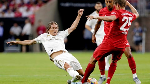 <p>               Real Madrid forward Gareth Bale, left, slides as he goes for the ball against FC Bayern's Thiago Alcântara, center, and Thomas Muller (25) during the first half of an International Champions Cup soccer match Saturday, July 20, 2019, in Houston. (AP Photo/Michael Wyke)             </p>