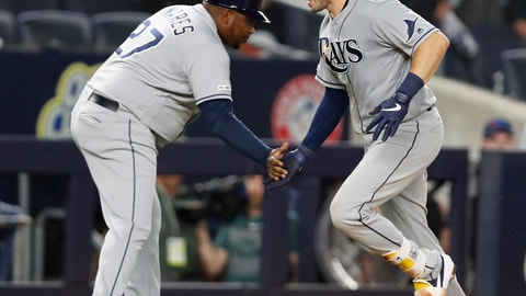<p>               Tampa Bay Rays' third base coach Rodney Linares, left, congratulates Travis d'Arnaud after d'Arnaud hit a three-run home run off New York Yankees' closer Aroldis Chapma during the ninth inning of a baseball game, Monday, July 15, 2019, in New York. (AP Photo/Kathy Willens)             </p>