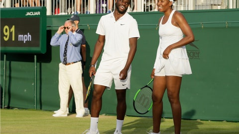 <p>               United States's Frances Tiafoe, left, and Venus Williams laugh during their Mixed Doubles match during day five of the Wimbledon Tennis Championships in London, Friday, July 5, 2019. (AP Photo/Tim Ireland)             </p>