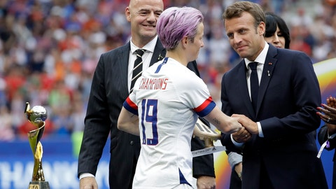<p>               French President Emmanuel Macron, right, and FIFA President Gianni Infantino , left, congratulate to United States' Megan Rapinoe, center, after the Women's World Cup final soccer match between US and The Netherlands at the Stade de Lyon in Decines, outside Lyon, France, Sunday, July 7, 2019. (AP Photo/Alessandra Tarantino)             </p>
